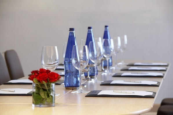 Glasses, water and notepads laid out at one of Galaxy Hotel's meetings events rooms for business purposes in Heraklion